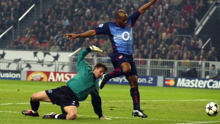 Sylvain Wiltord of Arsenal skips past Goalkeeper Bogdan Lobont of Ajax
