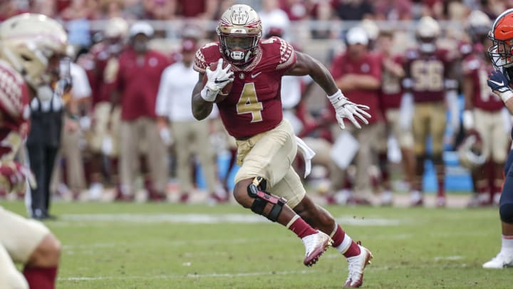 TALLAHASSEE, FL - OCTOBER 26: Runningback Khalan Laborn #4 of the Florida State Seminoles on a running play during the game against the Syracuse Orange at Doak Campbell Stadium on Bobby Bowden Field on October 26, 2019 in Tallahassee, Florida. The Seminoles defeated the Orange 35 to 17. (Photo by Don Juan Moore/Getty Images)