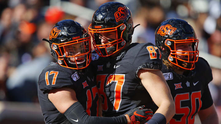 STILLWATER, OK - NOVEMBER 2:  Wide receiver Dillon Stoner #17 of the Oklahoma State Cowboys gets congratulated for his 57-yard touchdown catch by tight end Logan Carter #87 and offensive lineman Ry Schneider #50 against the TCU Horned Frogs on November 2, 2019 at Boone Pickens Stadium in Stillwater, Oklahoma.  OSU won 34-27.  (Photo by Brian Bahr/Getty Images)