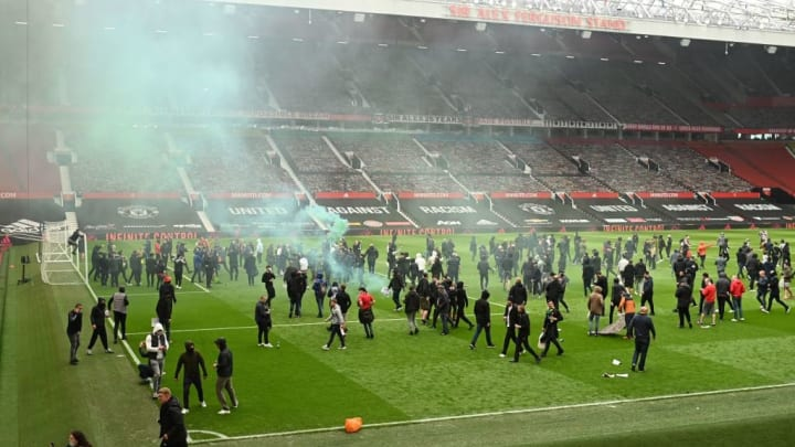 Hundreds of fans made their way onto the Old Trafford pitch