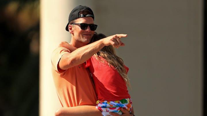 Tom Brady holding his daughter.