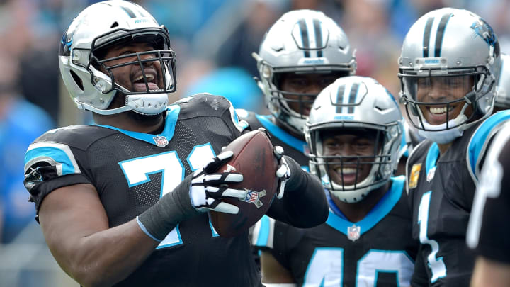 CHARLOTTE, NC - NOVEMBER 04:  Teammates watch as Marshall Newhouse #71 of the Carolina Panthers prepares to spike the football after a touchdown against the Tampa Bay Buccaneers during the first half of their game at Bank of America Stadium on November 4, 2018 in Charlotte, North Carolina.  (Photo by Grant Halverson/Getty Images)
