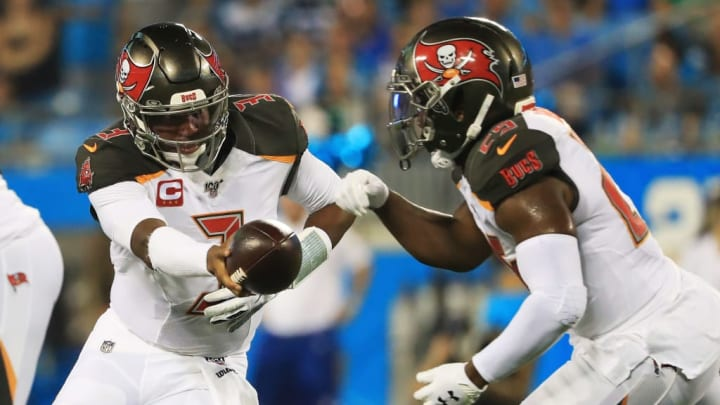CHARLOTTE, NORTH CAROLINA - SEPTEMBER 12: Quarterback Jameis Winston #3 hands offsides to running back Peyton Barber #25 of the Tampa Bay Buccaneers in the first quarter of the game against the Carolina Panthers at Bank of America Stadium on September 12, 2019 in Charlotte, North Carolina. (Photo by Streeter Lecka/Getty Images)