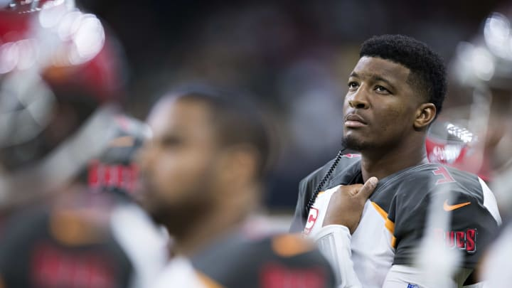 NEW ORLEANS, LA - NOVEMBER 5:  Jameis Winston #3 of the Tampa Bay Buccaneers watches a replay on the screen from the sidelines after being hurt in the first half of a game against the New Orleans Saints at Mercedes-Benz Superdome on November 5, 2017 in New Orleans, Louisiana.  The Saints defeated the Buccaneers 30-10.  (Photo by Wesley Hitt/Getty Images)