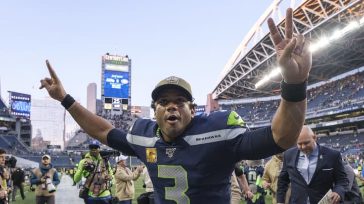 SEATTLE, WA - NOVEMBER 3: Russell Wilson #3 of the Seattle Seahawks celebrates as he leaves the field after a game against the Tampa Bay Buccaneers at CenturyLink Field on November 3, 2019 in Seattle, Washington. The Seahawks won 40-34 in overtime. (Photo by Stephen Brashear/Getty Images)