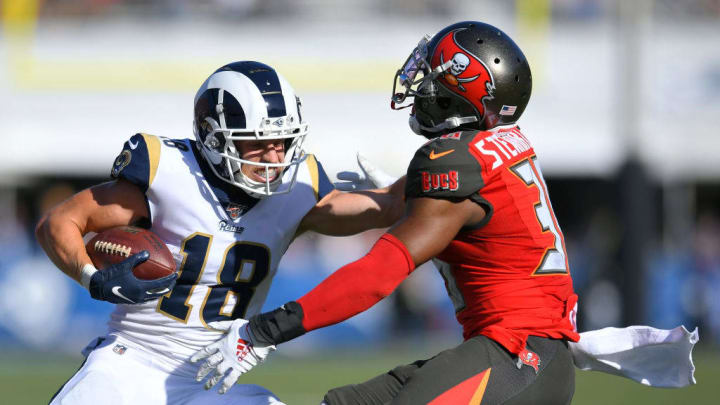 LOS ANGELES, CA - SEPTEMBER 29: Cooper Kupp #18 of the Los Angeles Rams straight arms M.J. Stewart #36 of the Tampa Bay Buccaneers before running in for a touchdown in the second half at Los Angeles Memorial Coliseum on September 29, 2019 in Los Angeles, California. Tampa Bay won 55-40. (Photo by John McCoy/Getty Images)