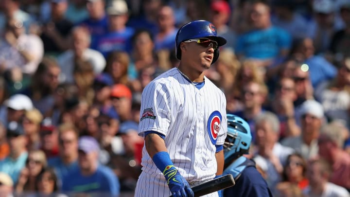 CHICAGO, IL - AUGUST 09: Javy Baez #9 of the Chicago Cubs walks back to the dugout after striking  in the 4th inning against the Tampa Bay Rays at Wrigley Field on August 9, 2014 in Chicago, Illinois. (Photo by Jonathan Daniel/Getty Images)