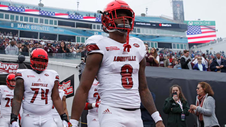 JACKSONVILLE, FL - DECEMBER 30: Lamar Jackson #8 of the Louisville Cardinals takes the field prior to the TaxSlayer Bowl against the Mississippi State Bulldogs at EverBank Field on December 30, 2017 in Jacksonville, Florida. (Photo by Joe Robbins/Getty Images)