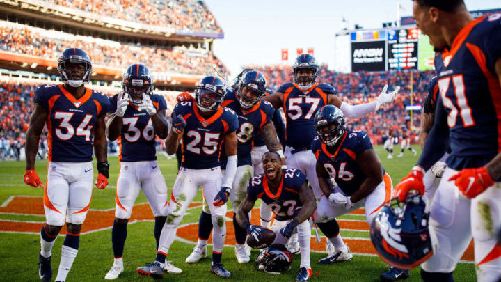 DENVER, CO - OCTOBER 13:  Defensive back Kareem Jackson #22 of the Denver Broncos celebrates in the end zone with the rest of the defense after an interception late in the fourth quarter against the Tennessee Titans at Empower Field at Mile High on October 13, 2019 in Denver, Colorado. The Broncos defeated the Titans 16-0. (Photo by Justin Edmonds/Getty Images)