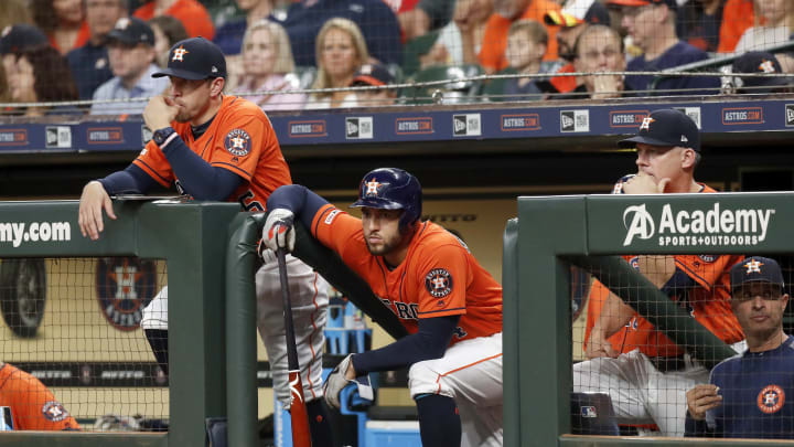 HOUSTON, TX - MAY 10:  George Springer #4 of the Houston Astros waits in the dugout before batting in the second inning against the Texas Rangers at Minute Maid Park on May 10, 2019 in Houston, Texas.  (Photo by Tim Warner/Getty Images)