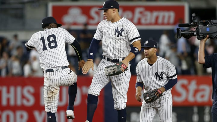 NEW YORK, NEW YORK - SEPTEMBER 04:   Didi Gregorius #18, Aaron Judge #99 and Gleyber Torres #25 of the New York Yankees celebrate after defeating the Texas Rangers at Yankee Stadium on September 04, 2019 in New York City. (Photo by Jim McIsaac/Getty Images)