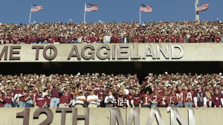 COLLEGE STATION, TX - NOVEMBER 28:  Texas A&M University Aggies fans, sometimes referred to as the 12th Man, stand during the game against the University of Texas at Austin Longhorns, at Kyle Field on November 28, 2003 in College Station, Texas.  The Texas Longhorns won 46-15.  (Photo by Brian Bahr/Getty Images)