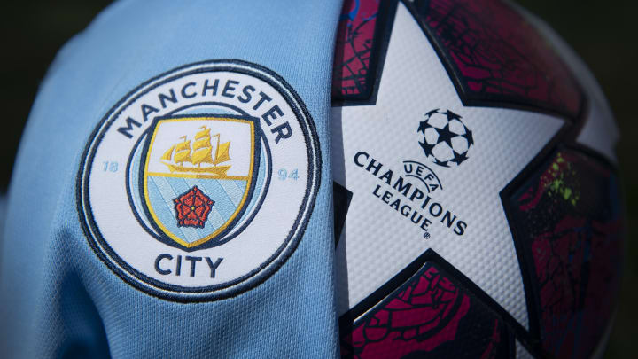 The Manchester City Club Crest with a Premier League Match Ball