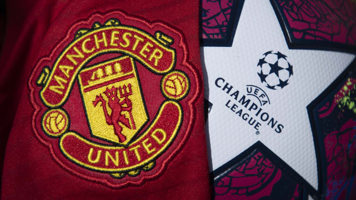 The Manchester United Club Crest with a Champions League Match Ball