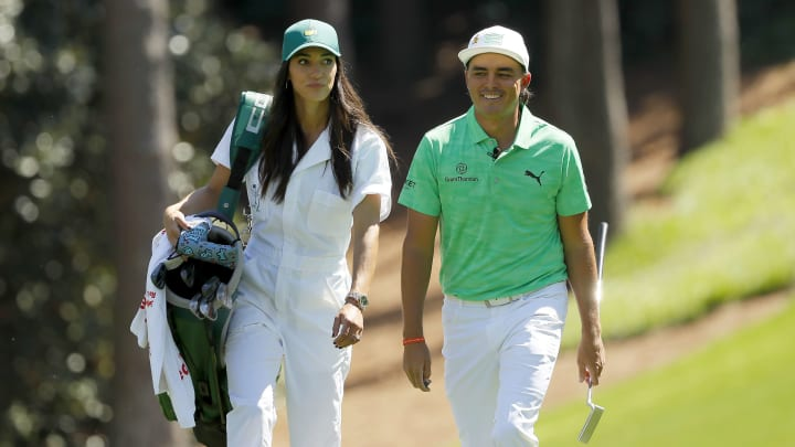 AUGUSTA, GEORGIA - APRIL 10: Rickie Fowler of the United States walks with fiancee Allison Stokke during the Par 3 Contest prior to the Masters at Augusta National Golf Club on April 10, 2019 in Augusta, Georgia. (Photo by Kevin C. Cox/Getty Images)