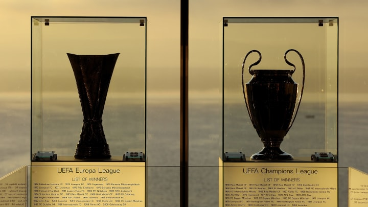 The UEFA Europa League trophy (L) and th