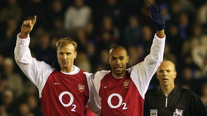 Thierry Henry of Arsenal celebrates scoring his 100th goal for Arsenal with Dennis Bergkamp of Arsenal