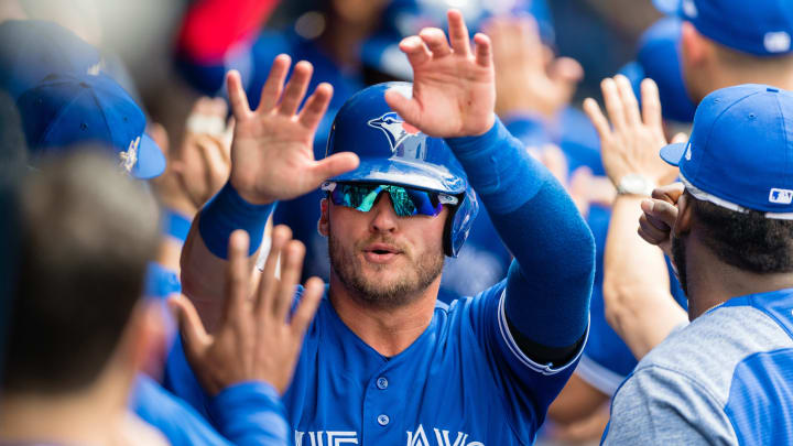 CLEVELAND, OH - MAY 3: Josh Donaldson #20 of the Toronto Blue Jays celebrates after scoring off a single by Yangervis Solarte #26 during the fourth inning against the Cleveland Indians at Progressive Field on May 3, 2018 in Cleveland, Ohio. All players are wearing #42 in honor of Jackie Robinson Day in this makeup game from April 15. (Photo by Jason Miller/Getty Images)