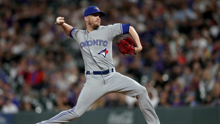 DENVER, COLORADO - JUNE 01: Pitcher Ken Giles #51 of the Toronto Blue Jays throws in the eighth inning against the Colorado Rockies at Coors Field on June 01, 2019 in Denver, Colorado. (Photo by Matthew Stockman/Getty Images)