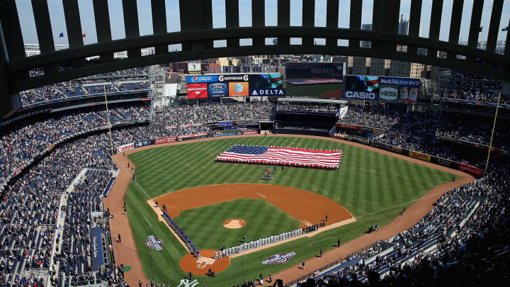 NEW YORK, NY - APRIL 06:  General view as the New York Yankees and the Toronto Blue Jays line up for the national anthems before Opening Day on April 6, 2015 at Yankee Stadium in the Bronx borough of New York City.  (Photo by Elsa/Getty Images)