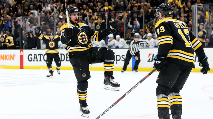 BOSTON, MASSACHUSETTS - APRIL 23: Marcus Johansson #90 of the Boston Bruins celebrates with Charlie Coyle #13 after scoring a goal against the Toronto Maple Leafs during the first period of Game Seven of the Eastern Conference First Round during the 2019 NHL Stanley Cup Playoffs at TD Garden on April 23, 2019 in Boston, Massachusetts. (Photo by Maddie Meyer/Getty Images)