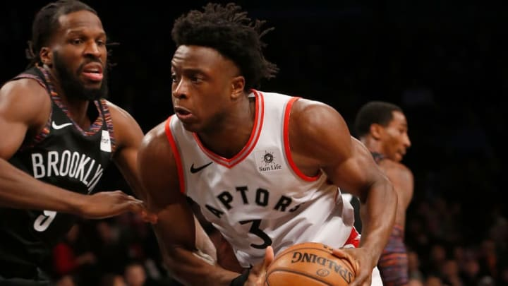 BROOKLYN, NY - DECEMBER 07:  (NEW YORK DAILIES OUT)    OG Anunoby #3 of the Toronto Raptors in action against DeMarre Carroll #9 of the Brooklyn Nets at Barclays Center on December 7, 2018 in the Brooklyn borough of New York City.  The Nets defeated the Raptors 106-105 in overtime. NOTE TO USER: User expressly acknowledges and agrees that, by downloading and/or using this photograph, user is consenting to the terms and conditions of the Getty Images License Agreement.  (Photo by Jim McIsaac/Getty Images)