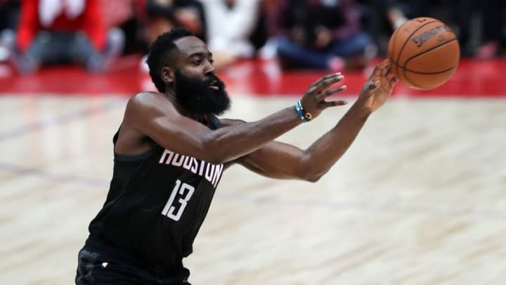 SAITAMA, JAPAN - OCTOBER 10: James Harden #13 of Houston Rockets passes the ball during the preseason game between Toronto Raptors and Houston Rockets at Saitama Super Arena on October 10, 2019 in Saitama, Japan. NOTE TO USER: User expressly acknowledges and agrees that, by downloading and/or using this photograph, user is consenting to the terms and conditions of the Getty Images License Agreement. (Photo by Takashi Aoyama/Getty Images)