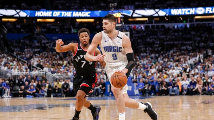 ORLANDO, FL - APRIL 19: Kyle Lowry #7 of the Toronto Raptors defends Nikola Vucevic #9 of the Orlando Magic during Game Three of the first round of the 2019 NBA Eastern Conference Playoffs at the Amway Center on April 19, 2019 in Orlando, Florida. The Raptors defeated the Magic 98 to 93. NOTE TO USER: User expressly acknowledges and agrees that, by downloading and or using this photograph, User is consenting to the terms and conditions of the Getty Images License Agreement. (Photo by Don Juan Moore/Getty Images)