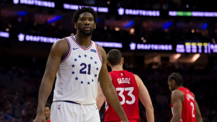 PHILADELPHIA, PA - MAY 09: Joel Embiid #21 of the Philadelphia 76ers looks on past Marc Gasol #33 and Kawhi Leonard #2 of the Toronto Raptors in Game Six of the Eastern Conference Semifinals at the Wells Fargo Center on May 9, 2019 in Philadelphia, Pennsylvania. The 76ers defeated the Raptors 112-101. NOTE TO USER: User expressly acknowledges and agrees that, by downloading and or using this photograph, User is consenting to the terms and conditions of the Getty Images License Agreement. (Photo by Mitchell Leff/Getty Images)