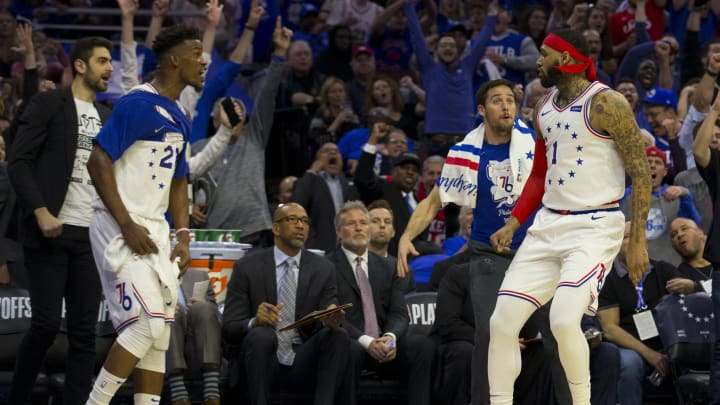 PHILADELPHIA, PA - MAY 09: Jimmy Butler #23 and T.J. McConnell #12 of the Philadelphia 76ers react after Mike Scott #1 made a three point basket against the Toronto Raptors in the third quarter of Game Six of the Eastern Conference Semifinals at the Wells Fargo Center on May 9, 2019 in Philadelphia, Pennsylvania. The 76ers defeated the Raptors 112-101. NOTE TO USER: User expressly acknowledges and agrees that, by downloading and or using this photograph, User is consenting to the terms and conditions of the Getty Images License Agreement. (Photo by Mitchell Leff/Getty Images)