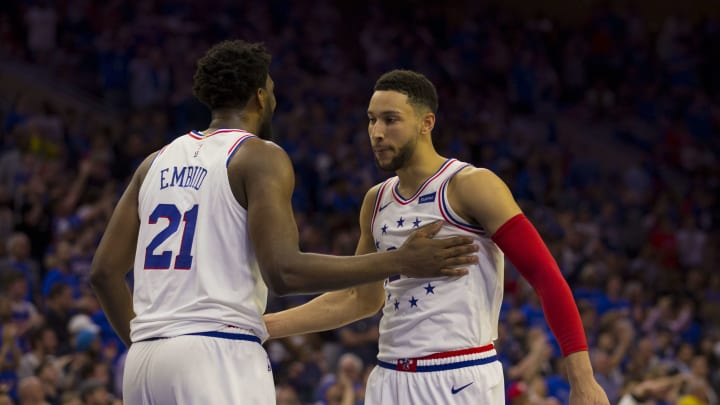 PHILADELPHIA, PA - MAY 02: Joel Embiid #21 of the Philadelphia 76ers celebrates with Ben Simmons #25 against the Toronto Raptors in Game Three of the Eastern Conference Semifinals at the Wells Fargo Center on May 2, 2019 in Philadelphia, Pennsylvania. The 76ers defeated the Raptors 116-95. NOTE TO USER: User expressly acknowledges and agrees that, by downloading and or using this photograph, User is consenting to the terms and conditions of the Getty Images License Agreement. (Photo by Mitchell Leff/Getty Images)