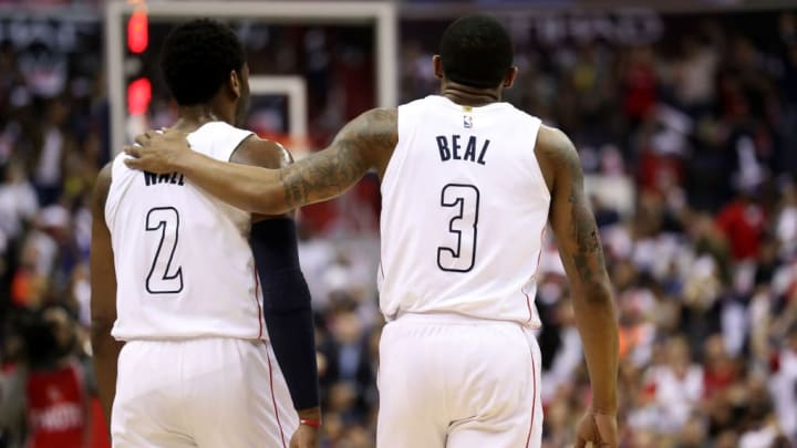 WASHINGTON, DC - APRIL 22: John Wall #2 and Bradley Beal #3 of the Washington Wizards talk on the floor in the first half against the Toronto Raptors during Game Four of Round One of the 2018 NBA Playoffs at Capital One Arena on April 22, 2018 in Washington, DC. NOTE TO USER: User expressly acknowledges and agrees that, by downloading and or using this photograph, User is consenting to the terms and conditions of the Getty Images License Agreement. (Photo by Rob Carr/Getty Images)