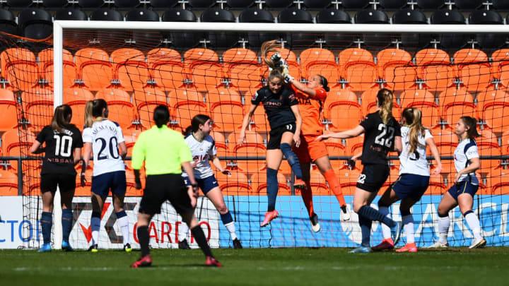 Spurs keeper Rebecca Spencer deals with a corner