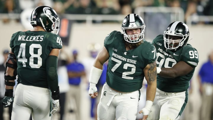EAST LANSING, MI - AUGUST 30: Mike Panasiuk #72 of the Michigan State Spartans celebrates after a tackle behind the line of scrimmage in the third quarter against the Tulsa Golden Hurricane at Spartan Stadium on August 30, 2019 in East Lansing, Michigan. (Photo by Joe Robbins/Getty Images)
