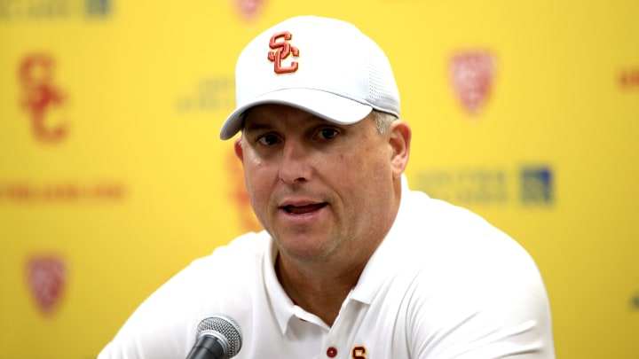 LOS ANGELES, CALIFORNIA - NOVEMBER 23:  Head coach Clay Helton of the USC Trojans speaks to the media after defeating the UCLA Bruins 52-35 in a game at Los Angeles Memorial Coliseum on November 23, 2019 in Los Angeles, California. (Photo by Sean M. Haffey/Getty Images)
