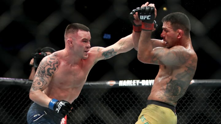 Colby Covington punches Rafael Dos Anjos in a UFC 225 victory.