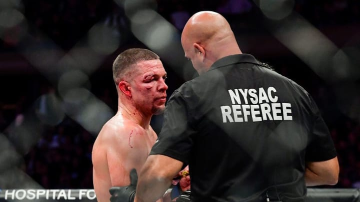 """NEW YORK, NEW YORK - NOVEMBER 02:  Nate Diaz of the United States is told the fight has been called off by TKO on a medical stoppage against Jorge Masvidal of the United States (R) in the Welterweight """"BMF"""" championship bout during UFC 244 at Madison Square Garden on November 02, 2019 in New York City. (Photo by Steven Ryan/Getty Images)"""