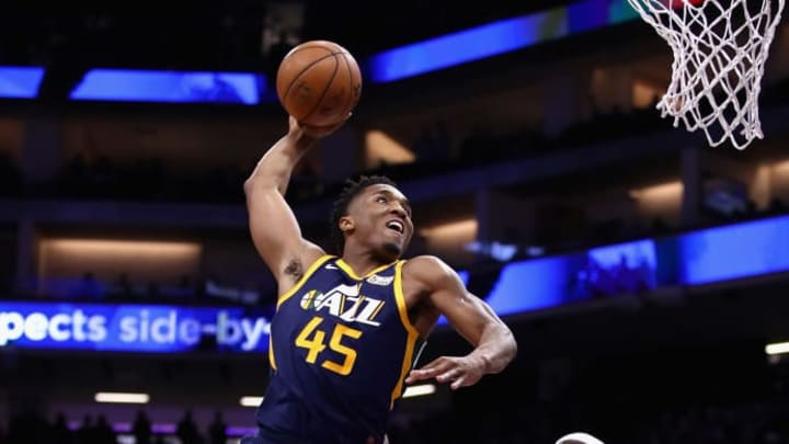 SACRAMENTO, CA - JANUARY 17:  Donovan Mitchell #45 of the Utah Jazz dunks on Zach Randolph #50 of the Sacramento Kings at Golden 1 Center on January 17, 2018 in Sacramento, California. NOTE TO USER: User expressly acknowledges and agrees that, by downloading and or using this photograph, User is consenting to the terms and conditions of the Getty Images License Agreement.  (Photo by Ezra Shaw/Getty Images)