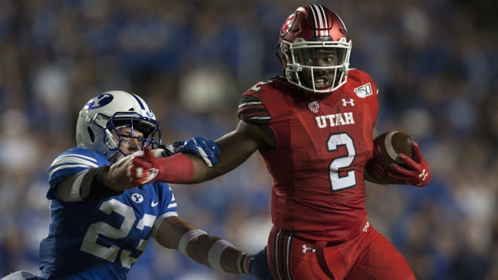 Utah running back Zack Moss sheds a tackle against BYU.