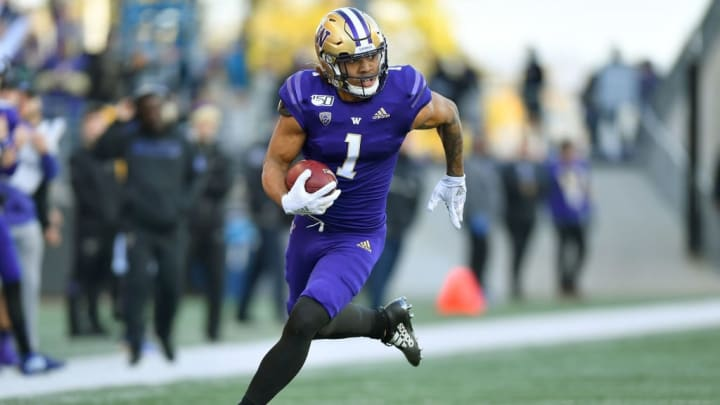 SEATTLE, WASHINGTON - NOVEMBER 02: Hunter Bryant #1 of the Washington Huskies scores on a 40 yard pass from Jacob Eason #10 during the middle of the third quarter of the game against the Utah Utes at Husky Stadium on November 02, 2019 in Seattle, Washington. The Utah Utes top the Washington Huskies 33-28. (Photo by Alika Jenner/Getty Images)