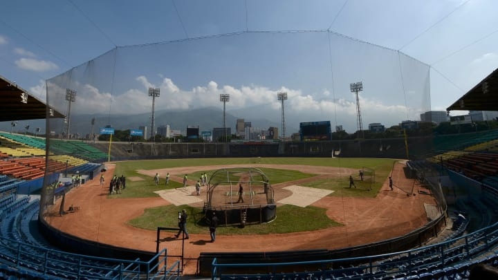 Players of the Venezuelan baseball team Leones del Caracas attend a training session at the Universitario stadium in Caracas, on September 18, 2017. While baseball is Venezuela's national sport, some fans are angry that the government, given the severity of the economic crisis and the political tension, will spend nearly ten million dollars on organizing the upcoming Winter League rather than on imports of food and medicine. / AFP PHOTO / FEDERICO PARRA        (Photo credit should read FEDERICO PARRA/AFP/Getty Images)