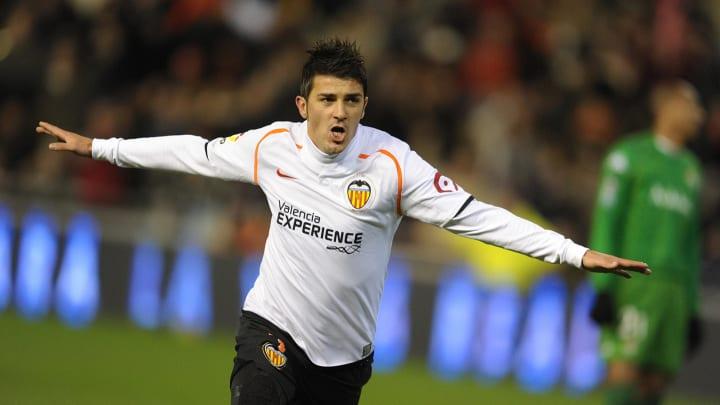 Valencia's  David Villa celebrates his g