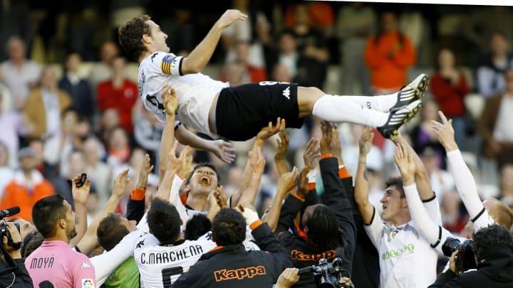 Valencia's Ruben Baraja is lifted by tea