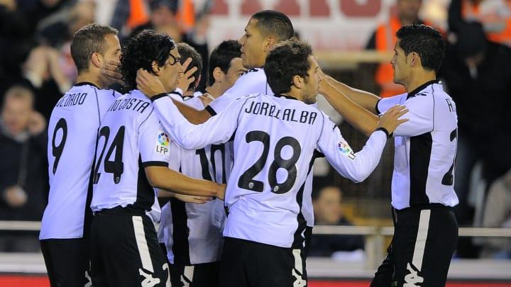 Valencia's players celebrate their secon