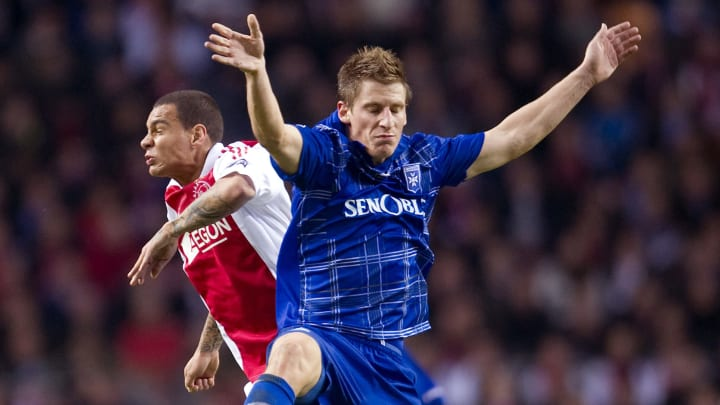Valter Birsa (R) of Auxerre fights for t