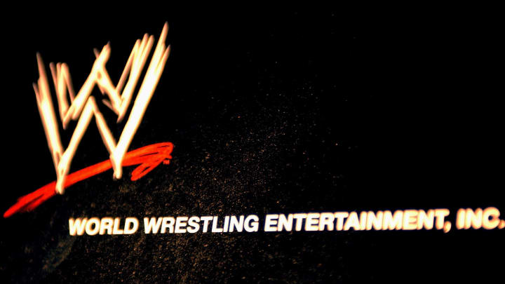 NEW YORK - MARCH 18:  The World Wrestling Entertainment logo hangs on a wall at a media conference announcing the all-star lineup of WWE WrestleMania XIX at ESPN Zone in Times Square March 18, 2003 in New York City.  (Photo by Mark Mainz/Getty Images)
