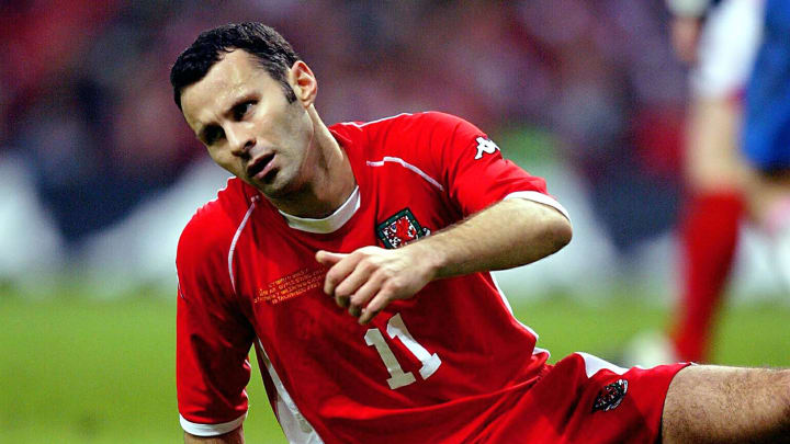 Wales' Ryan Giggs is on the floor as he missed an