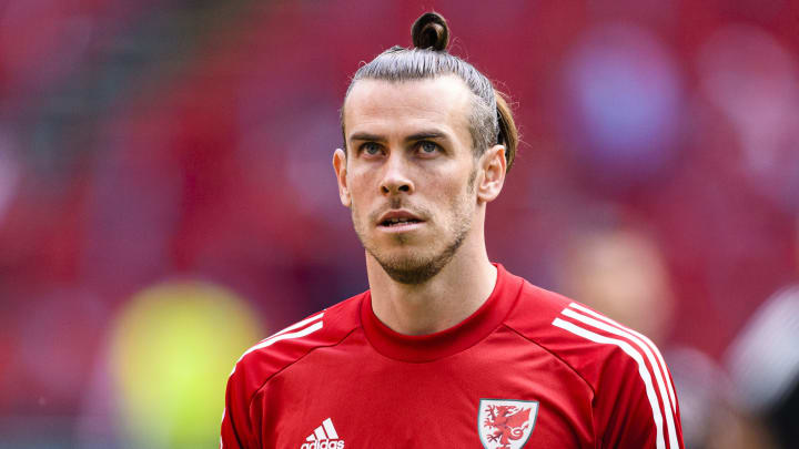 Gareth Bale could retire from club football next summer but keep playing for Wales if they qualify for the 2022 World Cup