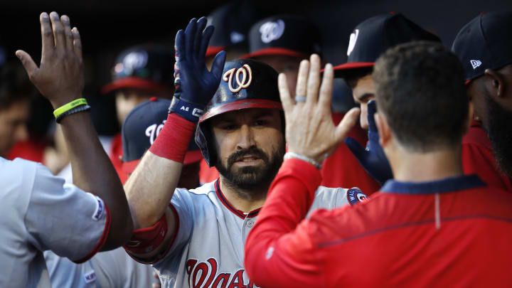 NEW YORK, NEW YORK - MAY 22: Adam Eaton #2 of the Washington Nationals celebrates with teammates in the dugout after hitting a home run against the New York Mets in the first inning during their game at Citi Field on May 22, 2019 in New York City. (Photo by Michael Owens/Getty Images)