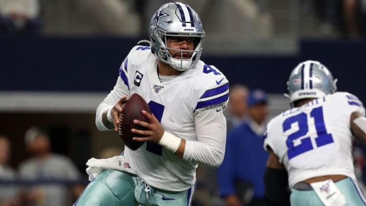 Dak Prescott rolls out of the pocket in a game against the Washington Redskins.